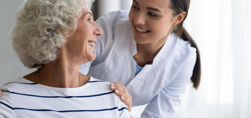A woman discusses safety with a senior woman.
