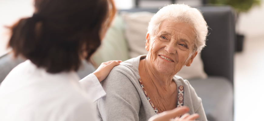 A doctor speaking with a senior resident at a NY nursing home.